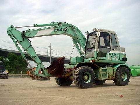 Máy xúc đào bánh lốp KOBELCO SK100-1